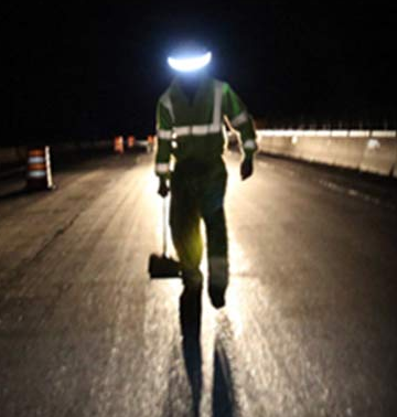 construction_worker_walking_in_dark_with_illuminated_hardhat